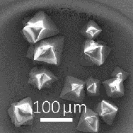 Octahedral crystal growth during photochemical etching of a GaAs wafer.
